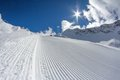 Perfectly groomed ski piste empty Stock Photos