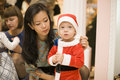 Perfomance for kids happy and his parents at new year eve party at the clothes shop russia november Stock Photo