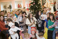Perfomance for kids happy and his parents at new year eve party at the clothes shop russia november Stock Photography