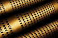 Perforated metal pipes abstract background of Royalty Free Stock Images