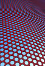 Perforated red panel with little round holes Stock Image