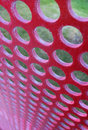 Perforated red panel with little round holes Royalty Free Stock Photos