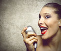 Performance of a beautiful woman singer female with vintage microphone Stock Photography