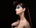Performance eccentric brunette with blue shine mask on her face art woman Royalty Free Stock Photo