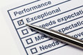 Performance evaluation paper with pen and tick marks Stock Photos