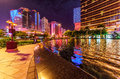 Performance Lake by the entrance of Macau Wynn Palace at night with architectural and street lighting. Scenic Macao cityscape Royalty Free Stock Photo