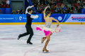 Performance of young skaters athletes in pairs short program Royalty Free Stock Photo