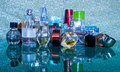 Perfume bottles different of blue pattern background Stock Images