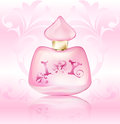 Perfume pink advertising bottle with a heart and floral ornament on a vintage patterned background Royalty Free Stock Photo
