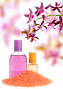 Perfume, salt and orchid Stock Images