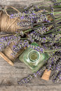 Perfumed herbal oil essence and lavender flowers vintage decora decoration top view selective focus Royalty Free Stock Image