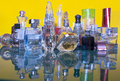 Perfumes bottles of perfume against a yellow background Royalty Free Stock Image