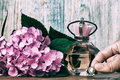 Perfumes and hydrangea on a blue wooden background