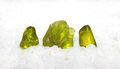 Peridote or olivine is a manganese iron silicate with a distinct translucent green colour used as a gemstone in jewellery and Stock Image