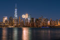 Perigee full moon over the skyscrapers of lower Manhattan-New Yo Royalty Free Stock Photo