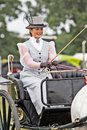 Period costume rider brockenhurst uk july an unnamed female gig driver parades her horse cart rig around the show ground at the Royalty Free Stock Photo