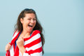 Perky laughter of a beautiful girl on the beach Royalty Free Stock Image