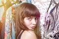 Perky teenage girl and her wardrobe toned image bokeh light leak Royalty Free Stock Images