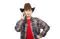 Perky young cowboy calling on smartphone paleface and looks at you white background Stock Image