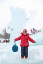 Perm russia jan little girl near sculpture of snow leopard winter olympics talisman in ice town created in honor of winter olympic Stock Image