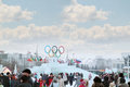 Perm russia jan people walk near symbol of olympic games in ice town created in honor winter games will be in sochi Stock Photos