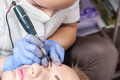 Permanent make up on eyebrows cosmetologist applying eyebrow tattoo Stock Photography