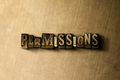 PERMISSIONS - close-up of grungy vintage typeset word on metal backdrop