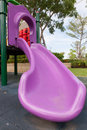 Perple plastic slide in a playground Royalty Free Stock Photo