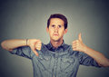 Perplexed man with thumbs down thumbs up gesture Royalty Free Stock Photo