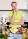 Perplexed woman with meat Royalty Free Stock Photo