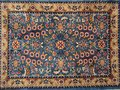 Persian rug turkish handwoven with floral design Stock Photos