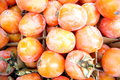 Persimmon red mature in the fruit shop for sale Royalty Free Stock Photo