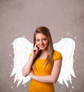 Person with angel illustrated wings on grungy background