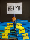 A person buried  under a pile of bill to pay asks  for help with Royalty Free Stock Photo