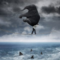 Person carrying an elephant above sea Royalty Free Stock Photo