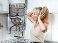 The person clasped the head hands housewife is upset gas water heater has broken Stock Images