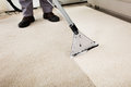 Person Cleaning Carpet With Vacuum Cleaner Royalty Free Stock Photo