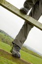 Person climbing over fence Royalty Free Stock Photo