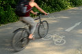 Person on a cycle lane motion blur of cyclist sunny day Stock Photo