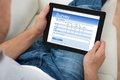 Person with digital tablet showing survey form close up of on sofa Royalty Free Stock Images
