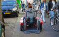 Person with disability transportation physically disabled in a wheelchair using a special device for locomotion Stock Images