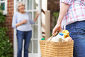Person doing shopping for elderly neighbour close up of Royalty Free Stock Image