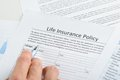 Person filling application for life insurance close up of hand policy form Royalty Free Stock Images
