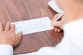 Person Filling Cheque Royalty Free Stock Photo