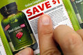 Person fingers on Irwin Naturals discount coupon. Royalty Free Stock Photo