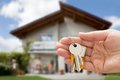 Person hand holding house key Royalty Free Stock Photo