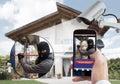 Person Hand Holding Mobile Phone Detecting Burglar Royalty Free Stock Photo