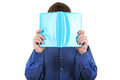 Person hide his face behind a book the hides the the isolated on the white background Royalty Free Stock Photos