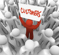 Person Holding Customers Sign in Crowd Royalty Free Stock Image