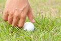 Person holding golf ball close up Stock Photo